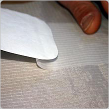 Keep easing off the backing paper till the patch is completely stuck down, make sure there are no air bubbles.